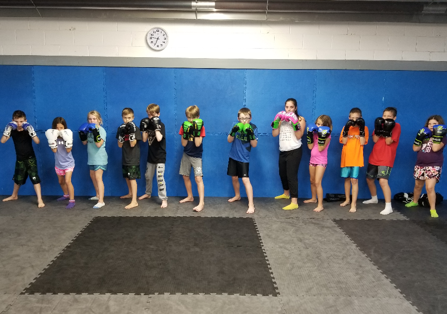 Kids Kickboxing Muay Thai Karate Boxing Self Defense Fitness Class Chatham Martial Arts youth children classes training bully bullies bullying mma boxing education ckont sport gym